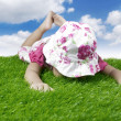 Baby laying on the meadow — Stock Photo #10032806