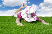 Baby laying on the meadow — Stock Photo