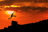 Man jump through the rock — Stock Photo