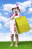 Little shopping girl — Stock Photo