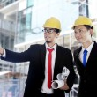 Asian businessmen at construction site — Stockfoto