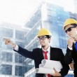 Asian businessmen at construction site — Stock Photo #10142725