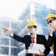 Asian businessmen at construction site - Stock Photo