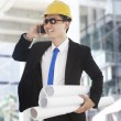 Asian engineer talking on the phone — Stock Photo