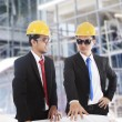 Engineers meeting at construction site - Stock Photo