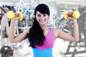 Working out with dumbbell — Stock Photo