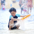 Asian boy playing at swimming pool — Stock Photo