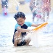 Asian boy playing at swimming pool — Stock Photo #10411705