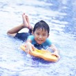 Joyful Asian kid at swimming pool — Stockfoto