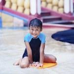 Cute Asian Kid smiling at swimming pool — Stock Photo