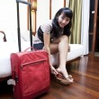 Asian woman in a hotel room - Stock Photo