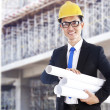 Asian developer with blueprints — Stock Photo