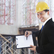 Supervisor showing blank clipboard — Stock Photo