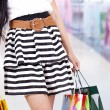Foto Stock: Woman with shopping bag