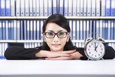 Asian businesswoman with alarm clock — Stock Photo