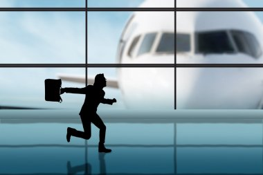 Businessman rushing in the airport
