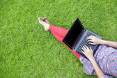 Female using laptop outdoor — Stock Photo