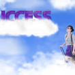 Businesswoman with success word over the cloud — Stock Photo
