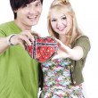 Couple holding a heart shaped box — Stock Photo