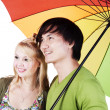 Stock Photo: Mixed race couple under umbrella
