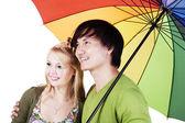 Mixed race couple under umbrella — Stock Photo