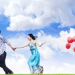 Couple running while holding hand — Stock Photo