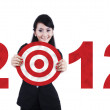 Asian business woman with 2012 business target — Stock Photo