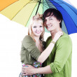 Stock Photo: Mixed race couple with umbrella