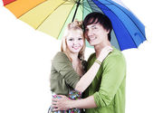 Mixed race couple with umbrella — Stock Photo