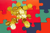 Coins with puzzle — Stock Photo