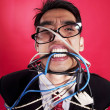 Mad businessman with cables — 图库照片