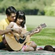Couple playing guitar — Stock Photo