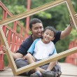 Father and son with a frame — Stock Photo