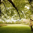 Kiss under the tree - Stock Photo