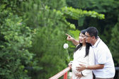 Happy pregnant couple looking at nature — Stock Photo