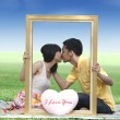 Lovers kissing in the park — Stock Photo #8575970