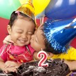 Brother kisses his sister on her birthday — Stock Photo #8616490