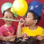 Sibling celebrating birthday 2 — Stock Photo