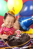 Brother kisses his sister on her birthday — Stock Photo
