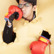 Businessman hit his face with boxing glove — Stockfoto