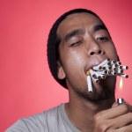 Smoker burn cigarettes — Stock Photo