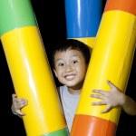 Happy small boy with playground equipment — Stock Photo