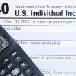 Electronic Tax form with calculator - Stock Photo