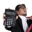 Stock Photo: Stressed businessmholding calculator asking for help