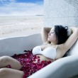 Woman having a leisure time in bathtub — Stock Photo