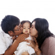 Happy Parents kissing daughter — Stock Photo
