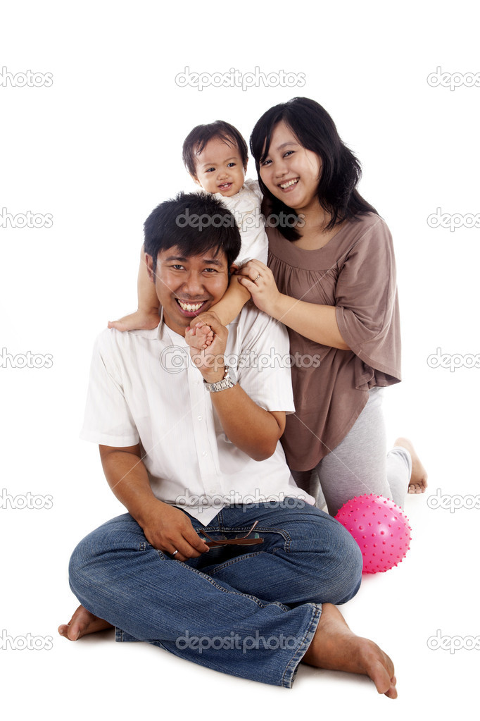 Happy asian family shot in studio isolated on white background — Stock Photo #8903447
