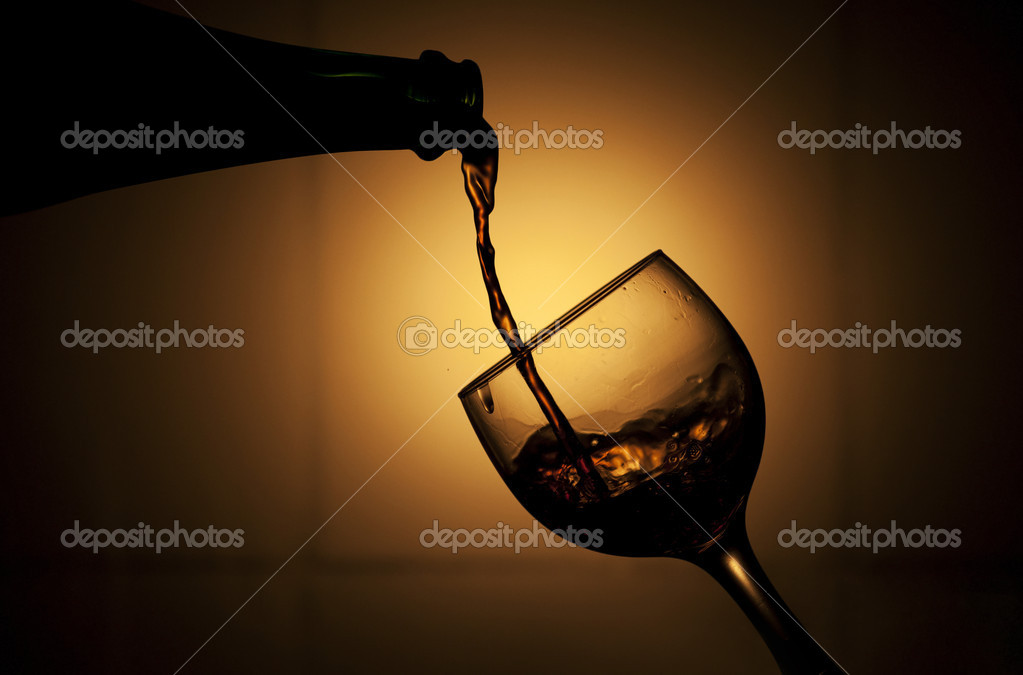 Pouring red wine into a glass — Stock Photo #8903848