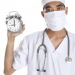 Doctor with alarm clock — Stock Photo #8982035