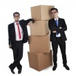 Businessmen with stack of boxes — Stock Photo